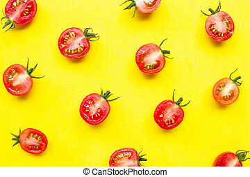 Fresh cherry tomatoes, half cut isolated on yellow background.