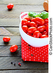 Fresh cherry tomatoes in a white bowl