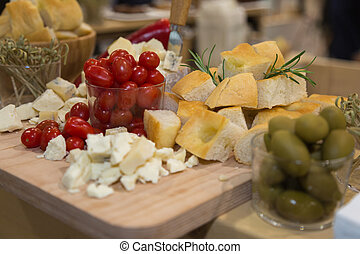 Fresh Cherry Tomatoes, Pieces of Cheese, Green Olives and Focaccia Cuts