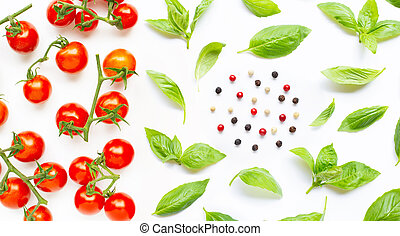 Fresh cherry tomatoes with basil leaves and different type of peppercorns