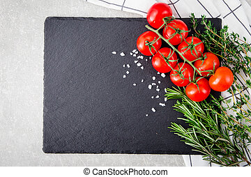 fresh cherry tomatoes with herbs and spices