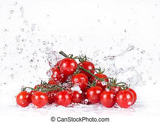 Fresh cherry tomatoes with water splash.