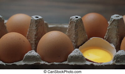 Fresh Chicken brown eggs in cardboard box on table. Slide shot