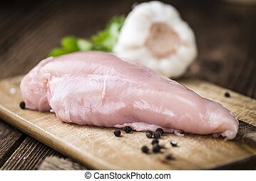 Fresh Chicken Fillet (selective focus; close-up shot) on...