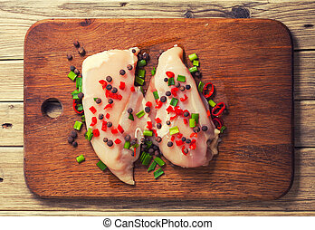 Fresh chicken meat on wooden board