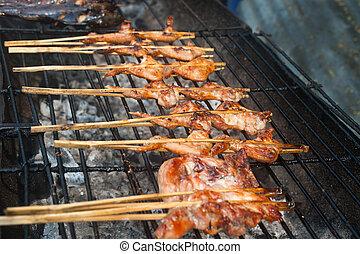 Fresh chicken on grill.