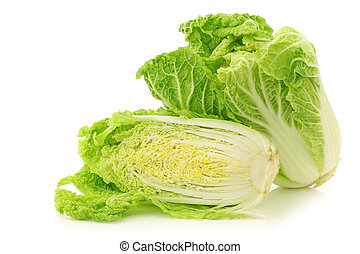 fresh chinese cabbage and a cut one on a white background