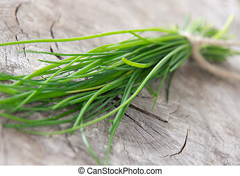 Fresh chive on wooden table