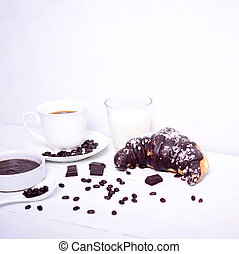 Fresh chocolate croissant with coffee on white background