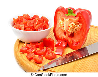 Fresh chopped bell pepper with a knife blade on cutting board