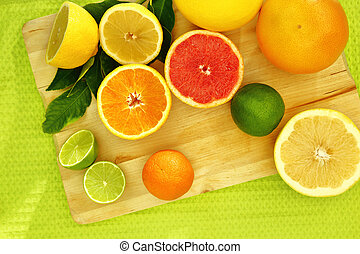 Fresh citrus fruit on a wooden tray