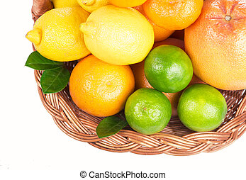 Fresh citrus fruit with leaves in a wicker basket