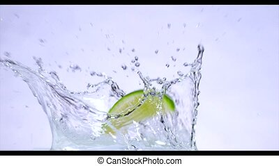 Fresh Citrus fruits fall into the water. Slow motion.