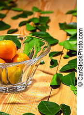 Fresh citrus fruits in the vase