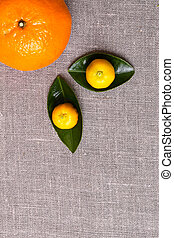 Fresh citrus fruits with leaves