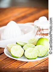 Fresh citrus lime wholes and slice with hand squash tool