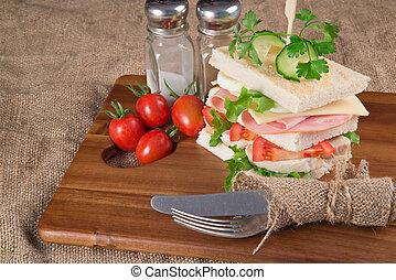 Rustic kitchen setting for fresh club sandwich