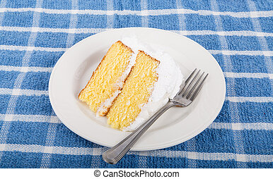 Fresh Coconut Cake on Blue Placemat - A slice of fresh...