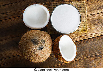 Fresh coconuts on old wooden background, Food top view