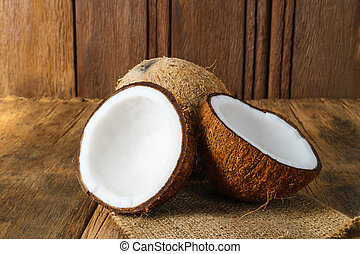 Fresh coconuts on old wooden background
