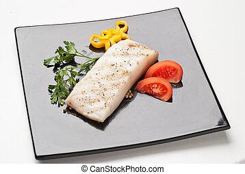 fresh cod on black dish - fresh cod served with vegetables ...