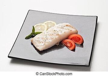 fresh cod on black dish