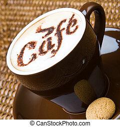 Fresh coffee - A hot cappuccino with an amaretti