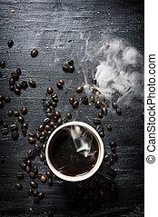 Fresh coffee and roasted grain .
