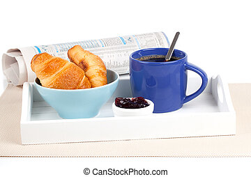 Fresh coffee and tasty croissant in a tray for breakfast. with newspaper, on white background