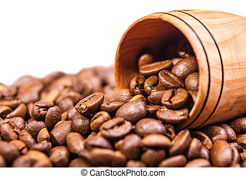 Fresh coffee beans in a wooden cup