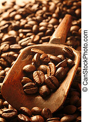 Fresh coffee beans in a wooden scoop - A background of fresh...