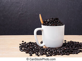 Fresh coffee in a cup of coffee on wooden