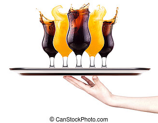 Fresh cola  with splash on a tray with hand
