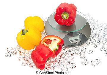 Fresh color paprika on digital scale