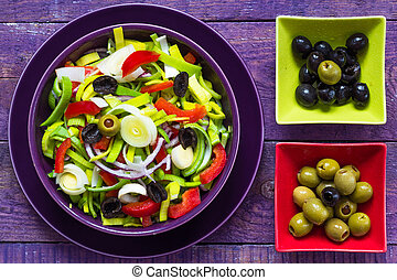 Fresh colorful vegetable salad platter wooden table
