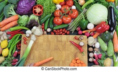 Fresh colorful vegetables with chopping board