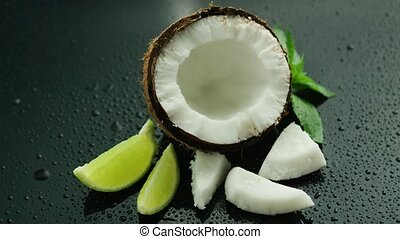Fresh composition of lime and coconut - White half of fresh...