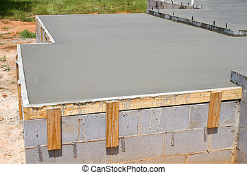 Fresh Concrete Slab - New construction of a freshly poured...