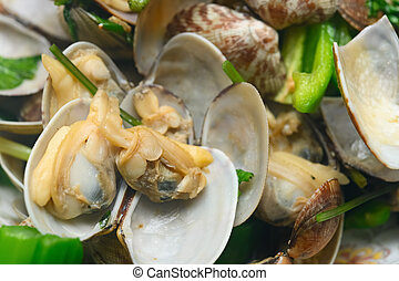 fresh cooked clams in a dish