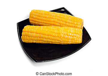 corn cob on black dish