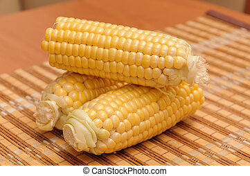 Fresh corn on cobs rustic wooden table, closeup