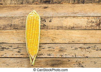 Fresh corn on wooden table background