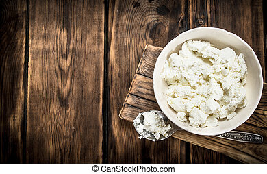 Fresh cottage cheese in a bowl .
