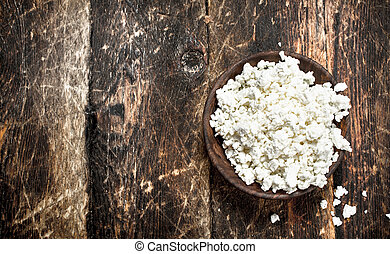 Fresh cottage cheese in a bowl.