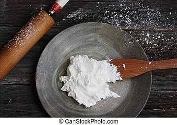 Fresh cottage cheese on a wooden table