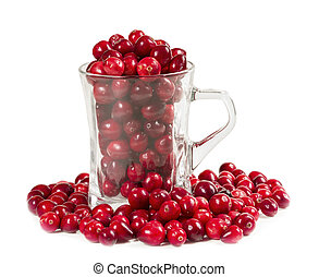 Fresh cranberries in a glass isolated on white background