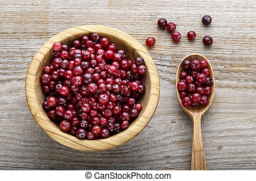 fresh cranberries in a plate and spoon