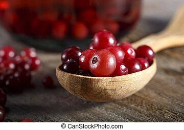 Fresh cranberries in a wooden spoon