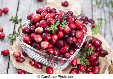 Fresh Cranberries on vintage wooden background
