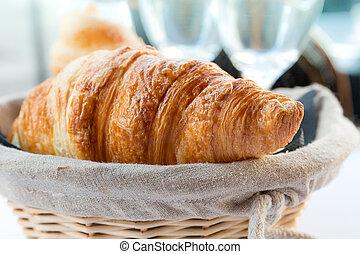 fresh croissants in a basket